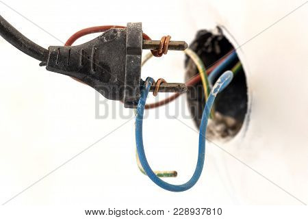 Badly Wired Plug Showing Bad And Wrong And Dangerous Connection