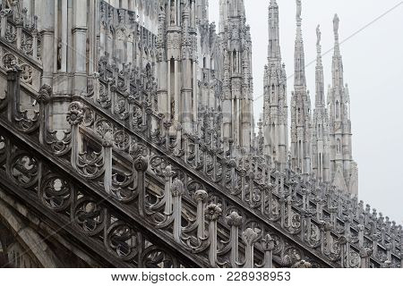Horizontal Perspective View Of Columns Statues And Towers On Gothic Architecture Milan Cathedral Dom