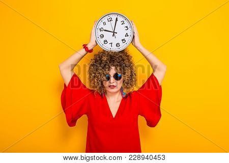 Portrait Of A White Woman With Afrro Curly Hairstyle In Red Dress And Sunglasses Holding Watches Abo
