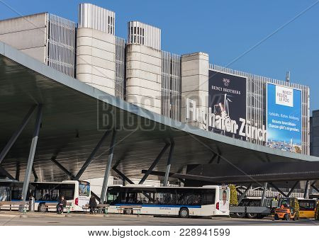 Kloten, Switzerland - 28 March, 2017: Building Of The Zurich Airport, Buses At The Bus Stop At It. T