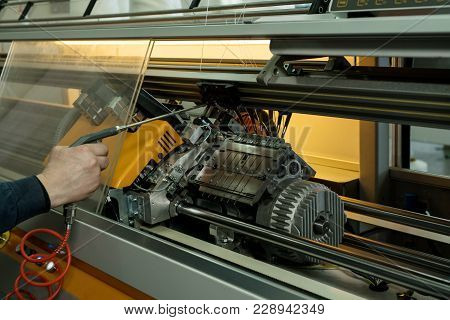 Serviceman Setting Up The Knitting Machine Close Up Cropped View