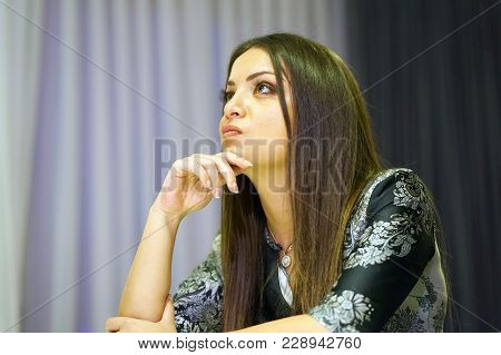 A Lonely Young Woman Sitting On The Couch At Home, She Is Depressed And Separated From Problems In H