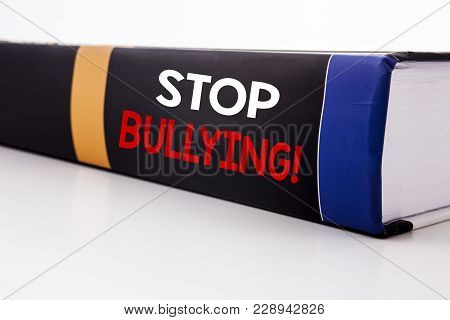 Conceptual hand writing text caption inspiration showing Stop Bullying. Business concept for Prevention Problem Bully written on the book the white background. poster