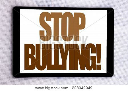 Hand writing text caption inspiration showing Stop Bullying. Business concept for Prevention Problem Bully written on tablet screen on white background. poster