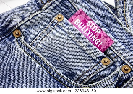 Handwriting Announcement text showing Stop Bullying. Business concept for Prevention Problem Bully Written on condom pack put in small pocket to pants jeans. poster