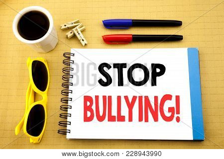 Writing text showing Stop Bullying. Business concept for Prevention Problem Bully written on sticky note with copy space on wood wooden background with sunglasses poster