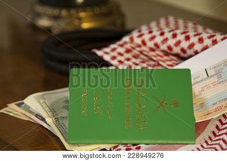 Saudi Passport, Ticket And Money Still Life With Saudi Shumagh