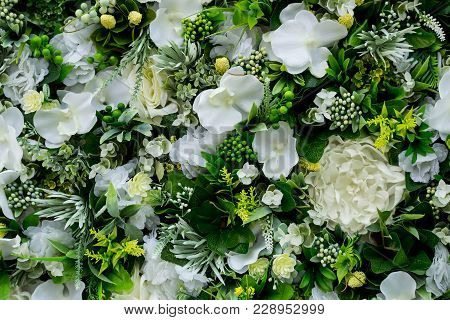 Colorful Floral Background Of White Eustoma, Hydrangeas, Other Flowers, Leaves And Decorative Branch