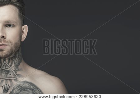 Cropped View Of Young Shirtless Tattooed Man, Isolated On Grey