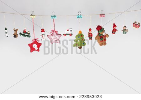 Christmas toys garland background on gray