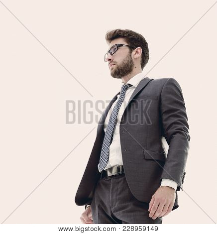 Confident serious businessman .. photo in full growth.