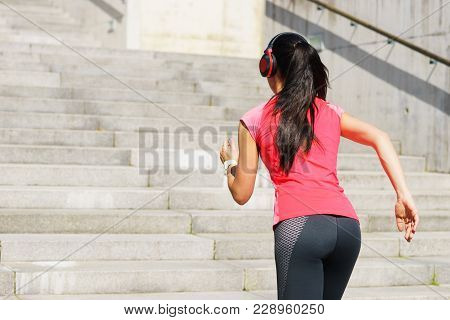 Young, Fit And Sporty Girl Running Up The Stairs. Fitness, Sport, Urban Jogging And Healthy Lifestyl