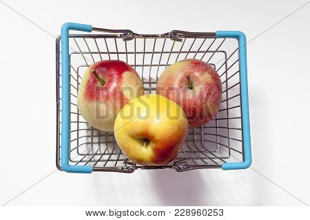 The Shopping Basket With Apple Isolated On White Background