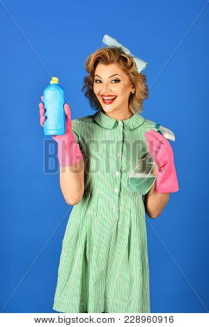 Cleaning, Retro Style, Purity. Retro Woman Cleaner On Blue Background. Housekeeper In Uniform With C