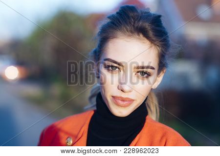 Girl With Make Up And Calm Face With Urban Background, Defocused. Young And Stylish Lady Outdoor Wit