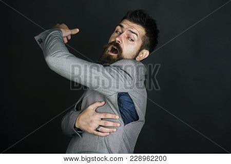 Hipster Chose Small Size Jacket, Seam Torn Under Armpit. Man With Beard Wears Jacket With Hole On Da