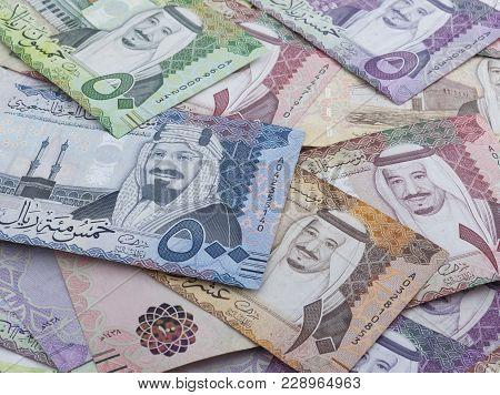 Heap of different Saudi Arabian Riyal Banknotes