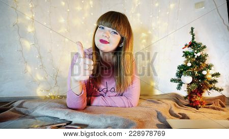 Cheerful Girl Raving Alone In Cozy Twinkling Room. Jocund Female Person Smiling And Enjoying Winter