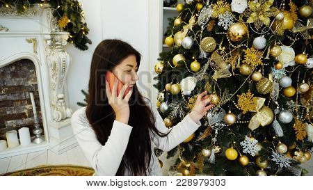Splendid Girl Talking On Phone And Ordering Gifts, Sits On Backg