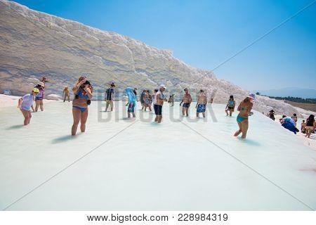 Pammukale, Turkey - July, 2015: tourists in Pammukale near modern turkey city Denizli. One of famous tourists place in Turkey.