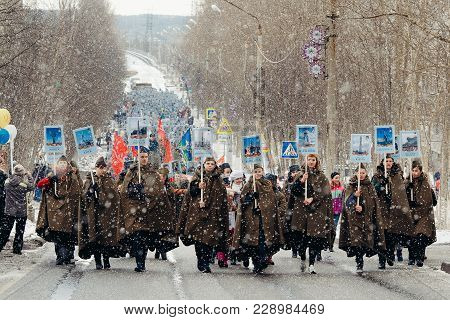 Murmansk, Russia - May 9, 2017: Immortal Regiment Procession In Victory Day. Thousands Of People Mar