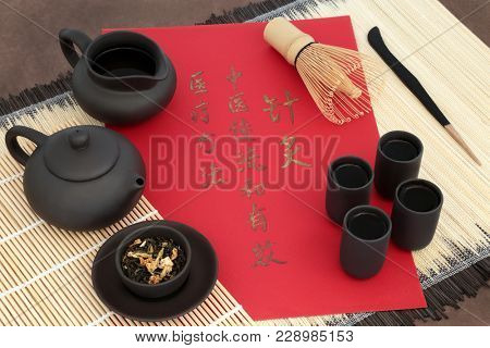 Green jasmine tea used in chinese herbal medicine with calligraphy script. Translation reads as chinese acupuncture is a traditional and effective medical solution.