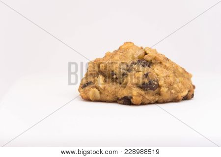 Isolated Cookie With Chocolate Chips And Oat Flakes