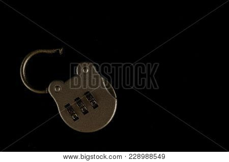 Close-up Of Combination Lock Object On A Black Background