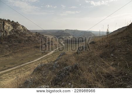 View With An Abandoned Quarry. There Are Two Hills And An Abandoned Quarry In A Background.