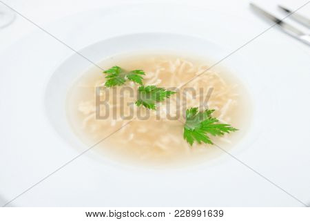Soup with pasta served on a plate