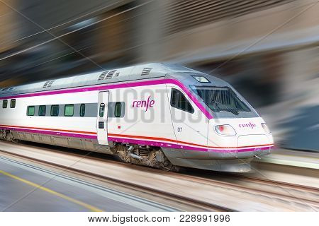 Modern Hi-speed Passenger Train Of Spanish Railways Company - Renfe, In  Movement (motion).