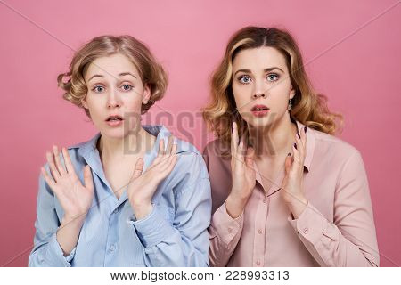 Two Young White-skinned Girls Are Stunned By The Incident And Opening Their Mouths With Their Hands.