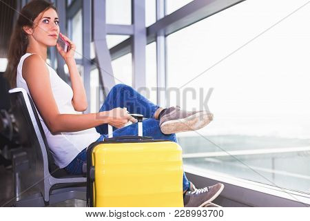Closeup Woman Carries Your Luggage At The Airport Terminal Of London, She Gonna Study Or Education F