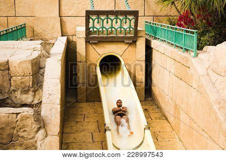 Dubai, United Arab Emirates - February 24, 2018: Tourist Taking The Ride On The Atlantis Water Park
