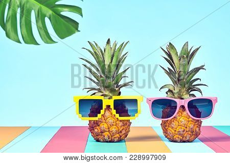 Two Hipster Fruits In Trendy Sunglasses, On Beach. Tropical Pineapple Couple. Bright Summer Color.fa