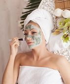 woman receiving spa treatment with cosmetic mask, skincare, antiaging, acne poster