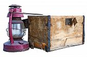 Worn old wooden chest and weathered kerosene lantern isolated on white with a clipping path poster