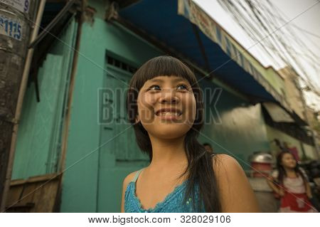 Ho Chi Minh (saigon), Vietnam - February 17, 2011: Cute Vietnamese Little Girl In The Alleys Of Saig