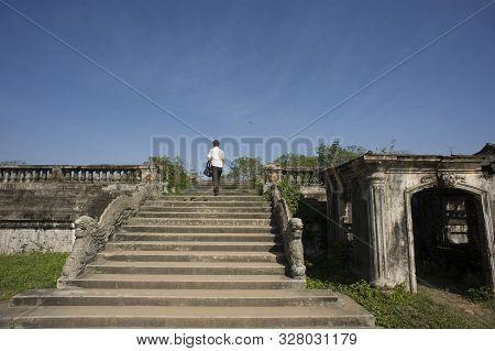 Hue, Thua Thien-hue, Vietnam - February 27, 2011: Tourist Climbing Staircase At Forbidden Purple Cit