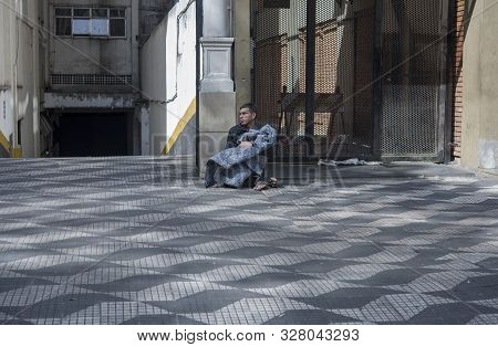 Sao Paulo, Brazil - December 12, 2015: Homeless Man On The Streets Of Sao Paulo. In 2019, The Govern