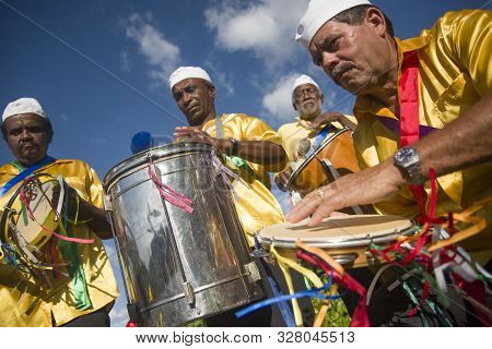 Gonçalves, Minas Gerais, Brazil - March 19, 2016: Brazilian Men In Costume Playing Drums, Celebratin