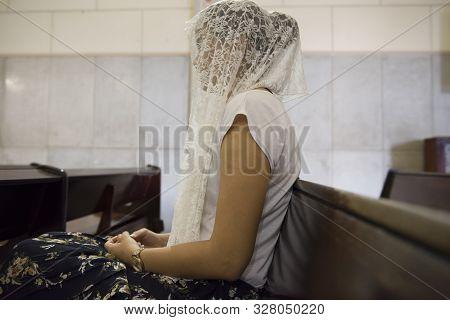 Sao Luis Do Maranhao, Maranhao, Brazil - May 18, 2016: Woman Wearing White Veil Praying At Church Of