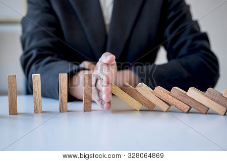 Risk And Strategy In Business, Image Of Hand Stopping Falling Collapse Wooden Block Dominoes Effect