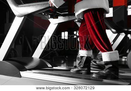 Authentic Santa Claus Training On Treadmill In Modern Gym, Closeup