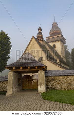 Ancient Gothic Catholic Church In Morning Fog, One Of The Most Valuable Religious Monuments In Slova