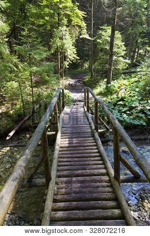 Pedestrian Wooden Bridge Over The Mountain River In Forest. Juráňová Valley ( Juranova Dolina ) - Ed