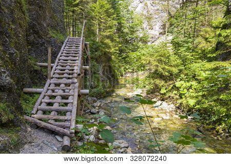 Pedestrian Wooden Bridge Along The River In  Mountain Gorge. Juráňová Valley ( Juranova Dolina ) - E