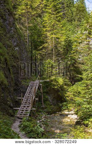 Pedestrian Wooden Bridge Along The River In  Forest Mountain Gorge. Juráňová Valley ( Juranova Dolin
