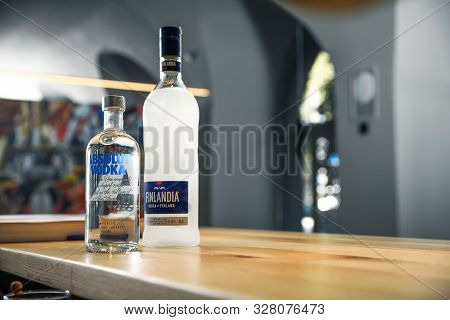Mykolaiv, Ukraine - September 23, 2019: Bottles Of Finlandia And Absolut Vodka On Wooden Counter In