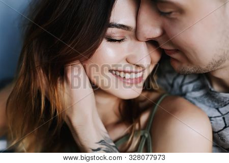 Kissing Couple Portrait. Young Couple Deeply In Love Sharing A Romantic Kiss